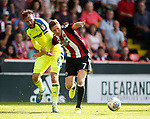John Lundstram of Sheffield Utd tussles with Richard Keogh of Derby County during the Championship match at Bramall Lane, Sheffield. Picture date 26th August 2017. Picture credit should read: Simon Bellis/Sportimage