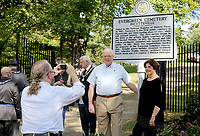 NWA Democrat-Gazette/DAVID GOTTSCHALK Charlie Alison (from left), secretary for the Fayetteville Evergreen Cemetery, photographs Friday, October 5, 2018, Lyle Sparkman, vice president of the Washington County Historical Society and Marilyn Heifner, president of the Fayetteville Evergreen Cemetery Association, following the dedication ceremony of a new historical marker at the Fayetteville Evergreen Cemetery. The new marker, from the Department of Arkansas Heritage, is the first in Northwest Arkansas and the second in the state to be installed. The cemetery was established in 1847 and added to the National Register of Historic Places in 1997.