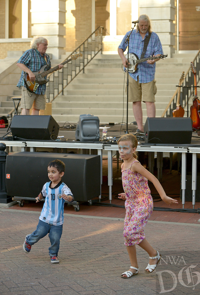 NWA Democrat-Gazette/BEN GOFF &bull; @NWABENGOFF<br /> Children dance as Trout Fishing in America plays on Friday Aug. 7, 2015 during the Back to School Celebration First Friday on the Bentonville square.