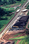 Carajas, Brazil. Aerial view of mine railhead with stockpile of ore; Carajas iron ore mine, Para State.