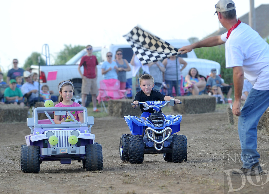 NWA Democrat-Gazette/MICHAEL WOODS • @NWAMICHAELW .... Brooklyn Roper, age 6 from Claremore, Oklahoma (left) edges out Brysen Cogdill, age 5 from Pea Ridge as they race to the finish line during the kids heat during the 5th annual lawnmower races Saturday evening July 25th in Pea Ridge.  The annual event sponsored by the Pea Ridge Lions Club draws lawnmower racing fans from across the region.