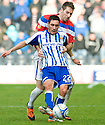 KILMARNOCK'S DANNY RACCHI HOLDS OFF RANGERS' KIRK BROADFOOT
