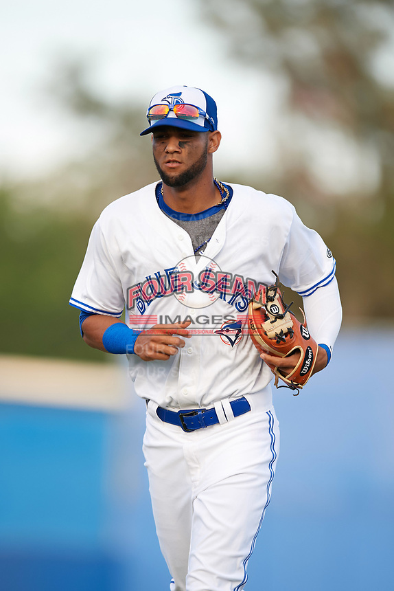 Dunedin Blue Jays shortstop Lourdes Gurriel (13) jogs to the dugout during a game against the St. Lucie Mets on April 19, 2017 at Florida Auto Exchange Stadium in Dunedin, Florida.  Dunedin defeated St. Lucie 9-1.  (Mike Janes/Four Seam Images)