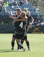 Christine Sinclair (left) celebrates her goal with Rachel Buehler (4) and Tiffeny Milbrett (right).  Washington Freedom defeated FC Gold Pride 4-3 at Buck Shaw Stadium in Santa Clara, California on April 26, 2009.