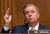 United States Senator Lindsey Graham (Republican of South Carolina) makes an opening statement as the  US Senate Committee on the Judiciary meets to vote on the nomination of Judge Brett Kavanaugh to be Associate Justice of the US Supreme Court to replace the retiring Justice Anthony Kennedy on Capitol Hill in Washington, DC on Friday, September 28, 2018.  If the committee votes in favor of Judge Kavanaugh then it goes to the full US Senate for a final vote.<br /> Credit: Ron Sachs / CNP<br /> (RESTRICTION: NO New York or New Jersey Newspapers or newspapers within a 75 mile radius of New York City)