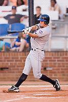 Left fielder Daniel Stegall (21) of the Kingsport Mets follows through on his swing at Howard Johnson Field in Johnson City, TN, Thursday July 3, 2008.