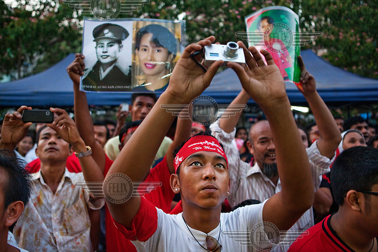 Supporters cheer and hold posters of Aung San Suu Kyi and her father General Aung San as Phyu Phyu Thin, National League for Democracy (NLD) candidate, campaigns ahead of by-elections in Yangon.