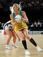27.08.2016 Australia's Clare McMeniman in action during the Netball Quad Series match between South Africa and Australia at Vector Arena in Auckland. Mandatory Photo Credit ©Michael Bradley.