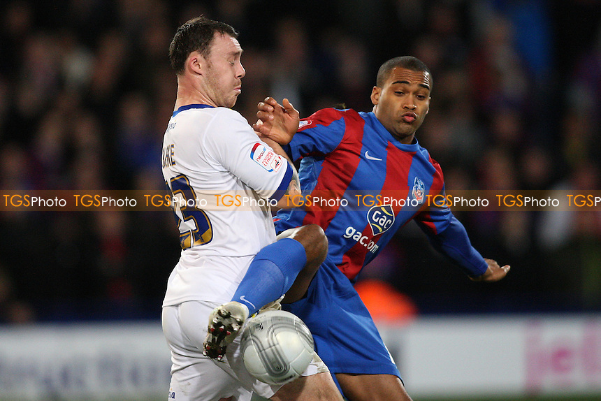 Jermaine Easter of Crystal Palace tangles with Darcy Blake of Cardiff City- Crystal Palace vs Cardiff City - Carling Cup Semi Final First Leg Football at Selhurst Park - 10/01/12 - MANDATORY CREDIT: George Phillipou/TGSPHOTO - Self billing applies where appropriate - 0845 094 6026 - contact@tgsphoto.co.uk - NO UNPAID USE.