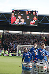 "Portsmouth 1 Southampton 1, 18/12/2012. Fratton Park, Championship. A samba band dressed in Portsmouth colours entertaining the crowd at Fratton Park stadium before their club take on local rivals Southampton in a Championship fixture. Around 3000 away fans were taken directly to the game in a fleet of buses in a police operation known as the ""coach bubble"" to avoid the possibility of disorder between rival fans. The match ended in a one-all draw watched by a near capacity crowd of 19,879. Photo by Colin McPherson."