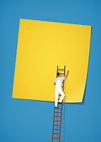 Workman pasting large blank sticky note to wall