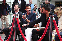 HOLLYWOOD, CA - MARCH 7: Jimmy Kimmel, Lionel Richie, Lisa Parigi and Miles Richie pictured at Lionel Richie's TCL Hand And Footprints Ceremony At The TCL Chinese Theatre IMAX In Hollywood, California on March 7, 2018. <br /> CAP/MPI/FS<br /> &copy;FS/MPI/Capital Pictures