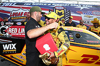 Sep 4, 2017; Clermont, IN, USA; NHRA funny car driver J.R. Todd celebrates with Dom Lagana after winning the US Nationals at Lucas Oil Raceway. Mandatory Credit: Mark J. Rebilas-USA TODAY Sports