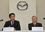 May 9, 2013, Tokyo, Japan - New President Masamichi Kogai of Japan's Mazda Motor Corp. speaks during a news conference in Tokyo on Thursday, May 9, 2013. The production and purchasing specialist replaces Takashi Yamanouchi, right, who led the automaker to its first annual profit in five years. (Photo by Natsuki Sakai/AFLO)