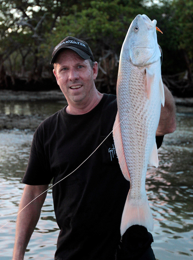 Tom Shurtleff on Jewell Key with a nice redfish in Florida's Everglades National Park out of Chokoloskee Island and the 10,000 Islands National Wildlife Refuge. Photo/Andrew Shurtleff