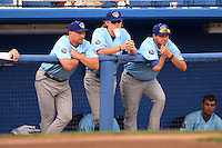 Daytona Cubs pitching coach Ron Villone (41), pitcher Rob Zastryzny (34) with a cup affixed to his chin, and pitcher Ben Wells (33) in the dugout during a game against the Dunedin Blue Jays on April 14, 2014 at Florida Auto Exchange Stadium in Dunedin, Florida.  Dunedin defeated Daytona 1-0  (Mike Janes/Four Seam Images)