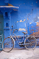A vintage bicycle has been left at the front door of a traditional Indian dwelling