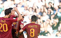 Calcio, Serie A: Napoli vs Roma. Napoli, stadio San Paolo, 15 ottobre. <br /> Roma&rsquo;s Edin Dzeko, second from right, celebrates with teammates after scoring during the Italian Serie A football match between Napoli and Roma at Naples' San Paolo stadium, 15 October 2016. Roma won 3-1.<br /> UPDATE IMAGES PRESS/Isabella Bonotto