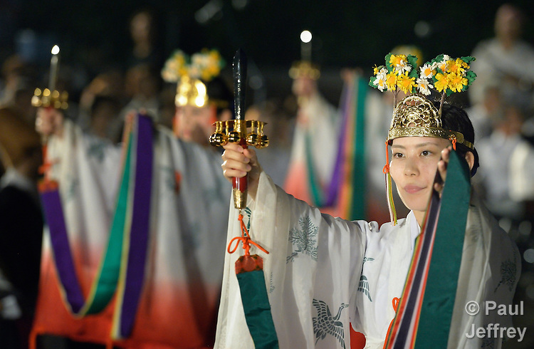 A woman performs a traditional dance during an interfaith service in Nagasaki, Japan, to commemorate those who died as the result of the U.S. atomic bomb dropped on the city in 1945. Participants in the service, which took place at the hypocenter of the blast, included a team of pilgrims from the World Council of Churches who came to Japan to see for themselves the results of the bombings 70 years ago, to listen to survivors and local church leaders, and to recommit themselves to new forms of advocacy for a world free of nuclear weapons.