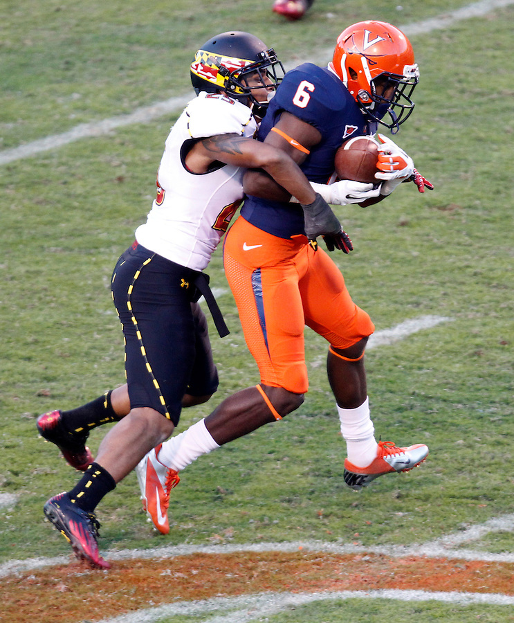 Virginia Cavaliers wide receiver Darius Jennings (6) makes a catch next to Maryland Terrapins defensive back Dexter McDougle (25) during the game in Charlottesville, Va. Maryland defeated Virginia 27-20.