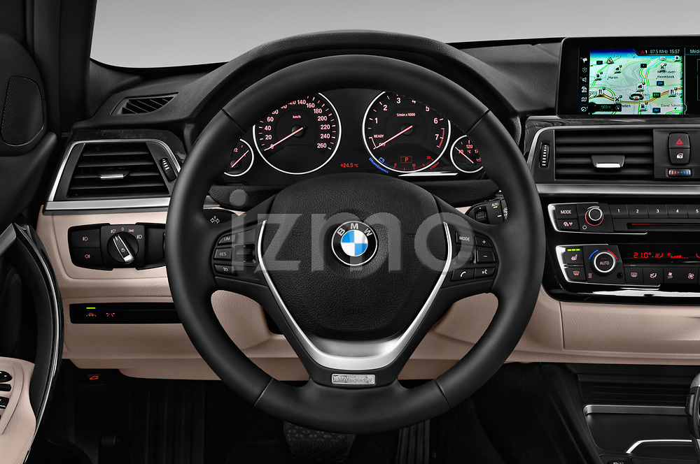 Car pictures of steering wheel view of a 2017 BMW 3 Series Touring Luxury 5 Door Wagon