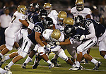 Action from a college football game between UC Davis and Nevada, in Reno, Nev., on Saturday, Sept. 7, 2013. (AP Photo/Cathleen Allison)