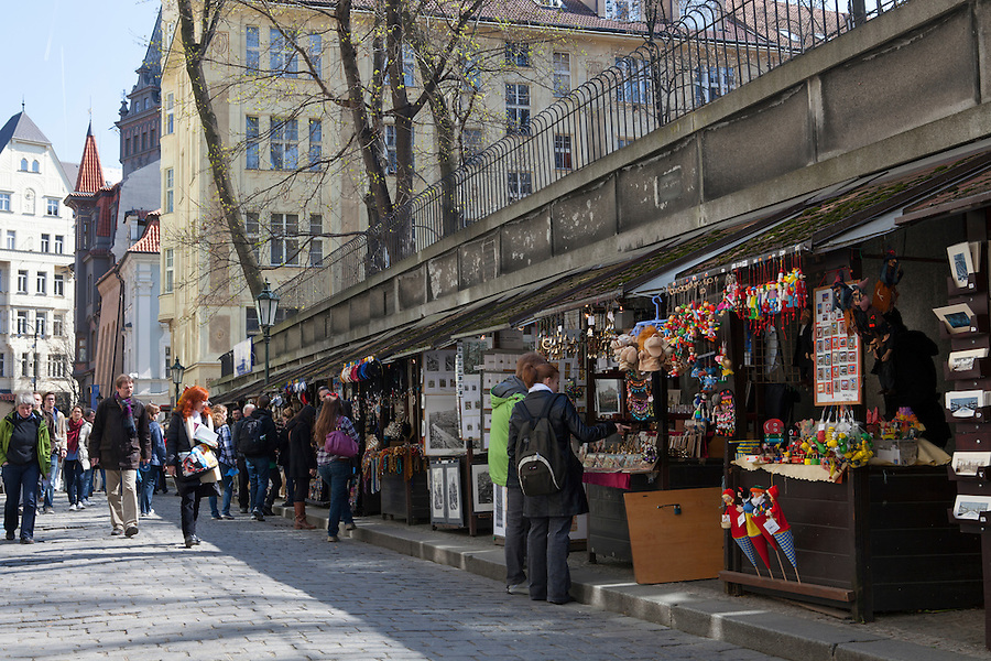 Tourists shop at vendors' stalls for prints, puppets and souvenirs on Hrbitova Street in Josefov, the Jewish Quarter, Prague, Czech Republic, Europe
