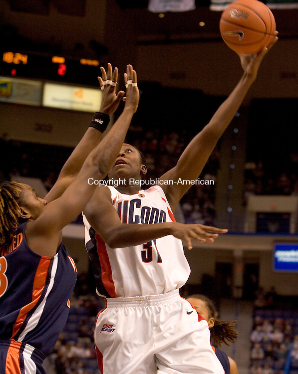 HARTFORD --05 DECEMBER 2007-120507JS02-UConn's Tina Charles puts up a shot over Virginia's Aisha Mohammed during their game Monday at the Hartford Civic Center.<br />  Jim Shannon/Republican-American