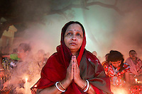Tears roll down the cheek of a Bangladeshi Hindu devotee offering prayers at a temple during Rakher Upabash in Narayanganj, near Dhaka, Bangladesh.
