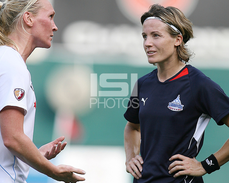 Sonia Bompastor #8 of the Washington Freedom talks to Frida Ostberg #18 of the Chicago Red Stars during a WPS match at RFK stadium on June 13 2009 in Washington D.C. The game ended in a 0-0 tie.