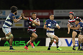 Luteru Laulala tries to fend off Akira Ioane. Mitre 10 Cup rugby game between Counties Manukau Steelers and Auckland played at ECOLight Stadium, Pukekohe on Saturday August 19th 2017. Counties Manukau Stelers won the game 16 - 14 and retain the Dan Bryant Memorial trophy.<br /> Photo by Richard Spranger.