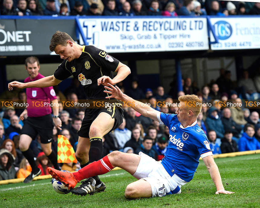 Eoin Doyle of Portsmouth slides in on Ben Nugent of Crewe Alexandra during Portsmouth vs Crewe Alexandra, Sky Bet EFL League 2 Football at Fratton Park on 4th March 2017