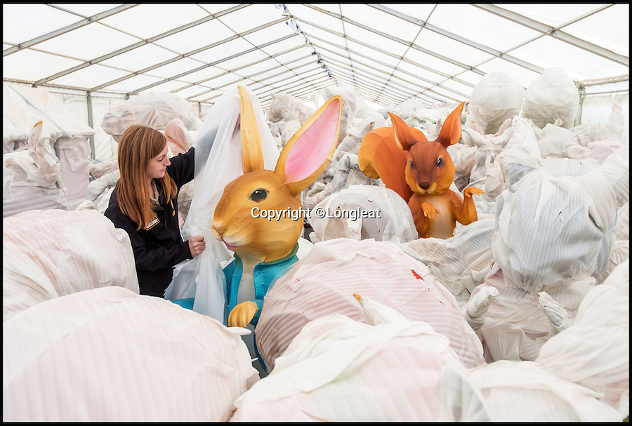 BNPS.co.uk ()1202 558833)<br /> Pic: PhilMumby/BNPS<br /> <br /> There's no keeping these cheeky characters under wraps...Amy O'Clark unwraps the Beatrix Potter characters set to shine at Longleat's Festival of Light this winter.<br /> <br /> Giant illuminated figures of Peter Rabbit and Squirrel Nutkin are among thousands of Chinese lanterns being unwrapped at Longleat in Wiltshire in preparation for its annual Festival of Light.<br /> <br /> The much-loved children's characters will feature in a series of scenes recreating famous extracts from the author's favourite stories to mark the 150th anniversary of her birth.
