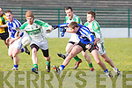 Ballydonoghue's John Enright and Diarmuid Behan closes off Templenoe's Adrain Spillane in the 1st round of the Novice Championship at Ballydonoghue on Saturday.