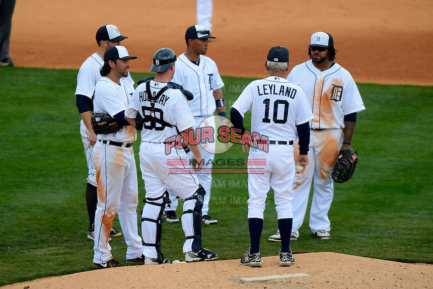 Detroit Tigers manager Jim Leyland #10 makes a pitching change as (L-R) Matt Tuiasosopo #68, Danny Worth #29, Ramon Santiago #39, and Prince Fielder #28 look on during a Spring Training game against the New York Mets at Joker Marchant Stadium on March 11, 2013 in Lakeland, Florida.  New York defeated Detroit 11-0.  (Mike Janes/Four Seam Images)
