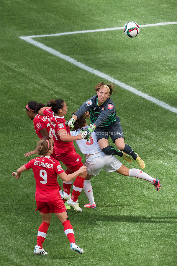 June 21, 2015: Gaelle THALMANN of Switzerland punches the ball during a round of 16 match between Canada and Switzerland at the FIFA Women's World Cup Canada 2015 at BC Place Stadium on 21 June 2015 in Vancouver, Canada. Canada won 1-0. Sydney Low/Asteriskimages.com