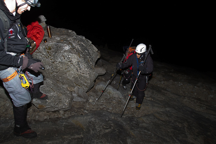 Blind soldier and climber Steve Baskis ascending the lower rock slabs of Lobuche in the middle of the night.