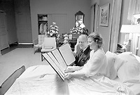 President and Mrs. Ford read a petition, signed by all 100 members of the United States Senate, in the President's Suite at Bethesda Naval Hospital, Bethesda, MD, following the First Lady's breast cancer surgery. October 2, 1974.