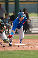 Chicago Cubs center fielder DJ Wilson (24) starts down the first base line during a Minor League Spring Training game against the Oakland Athletics at Sloan Park on March 13, 2018 in Mesa, Arizona. (Zachary Lucy/Four Seam Images)