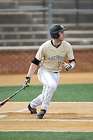 Johnny Aiello (2) of the Wake Forest Demon Deacons follows through on his swing against the Harvard Crimson at David F. Couch Ballpark on March 5, 2016 in Winston-Salem, North Carolina.  The Crimson defeated the Demon Deacons 6-3.  (Brian Westerholt/Four Seam Images)