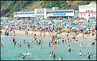 BNPS.co.uk (01202 558833)<br /> Pic:   RogerArbon/BNPS<br /> <br /> Brits head to the beach in Bournemouth, as the mercury rises even higher during the bank holiday weekend.
