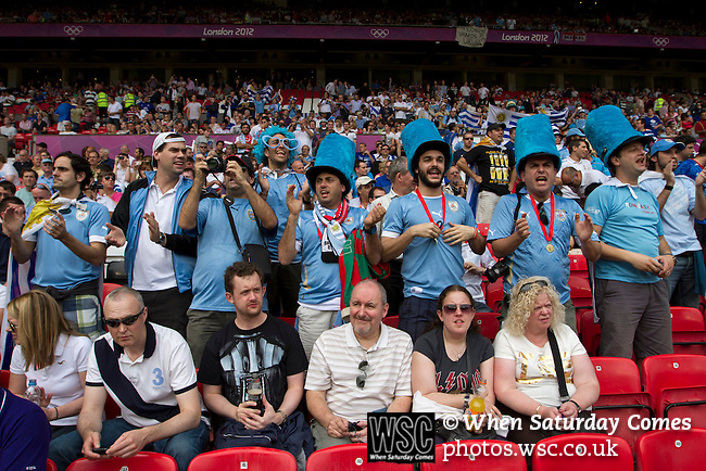 Uruguay 2 United Arab Emirates 1, Great Britain 1 Senegal 1, 26/07/2012. Old Trafford, Olympic Games. Supporters of the uruguay national team acclaim their team as it comes on to the pitch at Manchester United's Old Trafford stadium prior to the Men's Olympic Football tournament match at the venue. The double header of matches resulted in Uruguay defeating the United Arab Emirates by 2-1 while Great Britain and Senegal drew 1-1. Over 72,000 spectators attended the two Group A matches. Photo by Colin McPherson.