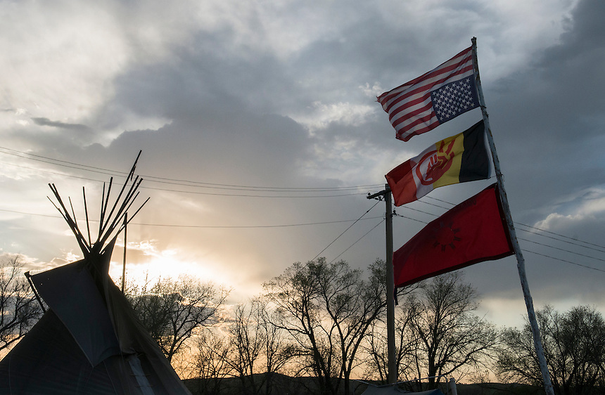 American flag upside down, the American Indian movement and Lakota flags at the Zero Tolerence camp. The young generation of Lakota warriors in their Zero Tolerance camp built on the border with White Clay,Nebraska. The student lead movement declared- The myth of the drunken Indian is over. The town of White Clay has four houses and seven liquor stores. A significant part of Whiteclay's economy is based on alcohol sales to residents of the Pine Ridge Indian Reservation, located two miles north across the border in South Dakota, where alcohol consumption and possession is prohibited. According to the Nebraska Liquor Control Commission, beer sales at Whiteclay's four liquor stores totaled 4.9 million cans per year.