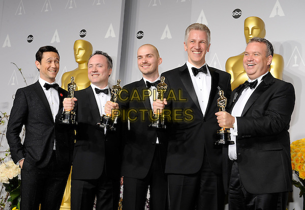 HOLLYWOOD, CA - MARCH 2: Joseph Gordon-Levitt, Timothy Webber, Neil Corbould, Chris Lawrence, David Shirk in the press room at the 2014 Oscars at the Hollywood and Highland Center in Hollywood, California. March 2, 2014. <br /> CAP/MPI/COR99<br /> &copy;COR99/MediaPunch/Capital Pictures