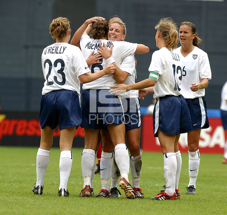 Aly Wagner, center, and team celebrate , USWNT vs Canada April 26, 2003.