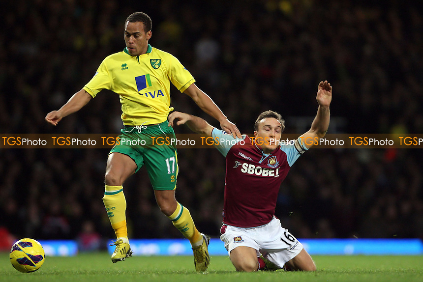 Mark Noble of West Ham is brought down by Elliott Bennett of Norwich - West Ham United vs Norwich City, Barclays Premier League at Upton Park, West Ham - 01/01/13 - MANDATORY CREDIT: Rob Newell/TGSPHOTO - Self billing applies where appropriate - 0845 094 6026 - contact@tgsphoto.co.uk - NO UNPAID USE.