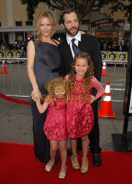 "JUDD APATOW, MAUDE APATOW, IRIS APATOW & LESLIE MANN.The Universal Pictures' World Premiere of ""Knocked Up"" held at The Mann's Village Theatre in Westwood, California, USA..May 21th, 2007.full length black dress suit pink dress kids children family .CAP/DVS.©Debbie VanStory/Capital Pictures"