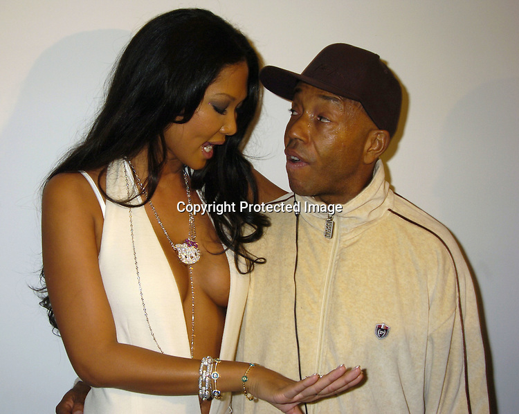 Kimora Lee Simmons and Russell Simmons..at The Baby Phat Fall 2005 Fashion Show on February 5, 2005 at Skylight. Photo By Robin Platzer, Twin Images