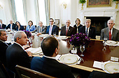 United States President Donald Trump flanked by  Secretary of State Rex Tillerson (R) and  Vice President Mike Pence (L) speaks as President Abdel Fattah Al Sisi of Egypt  sits on the other side of the table during a working lunch in the State Dining Room  of White House in Washington, DC, April 3, 2017.<br /> Credit: Olivier Douliery / Pool via CNP