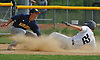 Johnny Castagnozzi #10 of Massapequa, left, tags out Frank Trotta #22 of Oceanside as he slides into third base to end the bottom of the fourth inning of the Nassau County varsity baseball Class AA final at SUNY Old Westbury on Saturday, May 26, 2018. Massapequa won 6-5 to take Game 1 of the best-of-three series.